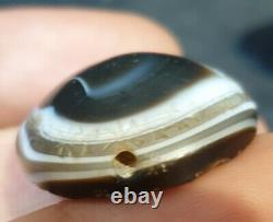 Circa near eastern stone eye bead with cuneiform writings. Extremely rare